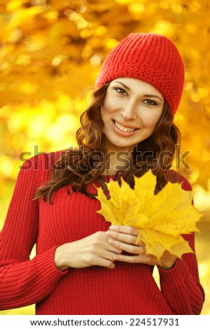 Portrait of a beautiful young woman in autumn park