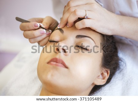 Portrait of a beautiful young woman in cosmetic salon. Close up. Beauty treatments - stock photo