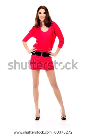 Portrait of a beautiful young woman in red dress. Isolated over white background. - stock photo