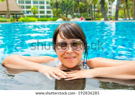 Portrait of a beautiful young woman in sunglasses in the pool. Concept photo healthy lifestyle     - stock photo