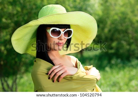 Portrait of a beautiful young woman in sunglasses posing outdoor.