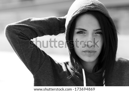 Portrait of a beautiful young woman in urban background - stock photo