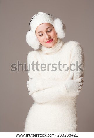 Portrait of a beautiful young woman in warm and cozy clothes.