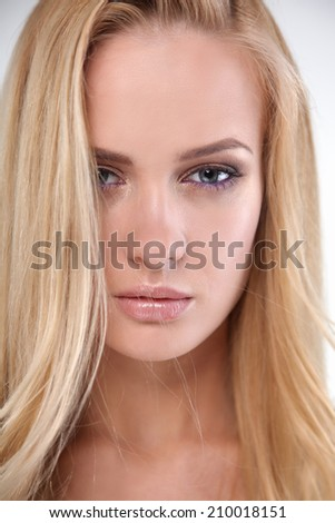 Portrait of a beautiful young woman , isolated on white background
