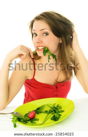 portrait of a beautiful young woman keeping a diet and eating vegetables - stock photo