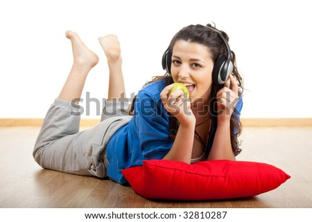 Portrait of a beautiful young woman listening music