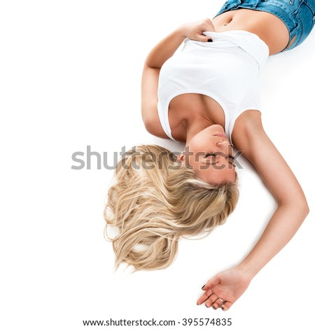 Portrait of a beautiful young woman lying on a white background