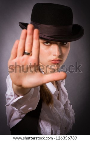 Portrait of a beautiful young woman making stop gesture. ��¡loseup. - stock photo