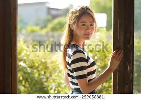 Portrait of a beautiful young woman on afternoon. - stock photo