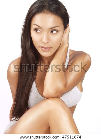Portrait of a beautiful young woman on white background.