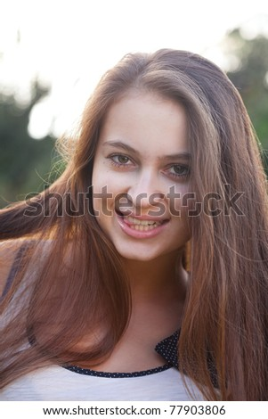 portrait of a beautiful young woman outdoor - stock photo