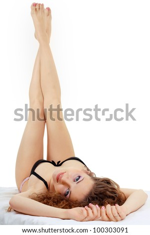 Portrait of a beautiful young woman posing in lingerie - stock photo