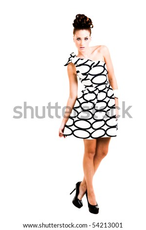 Portrait of a beautiful young woman  She is dressed in a black and white dress. Vertical shot. - stock photo