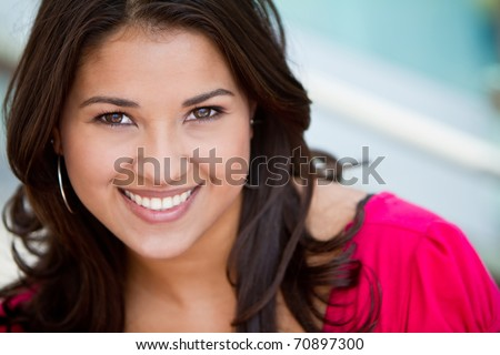 Portrait of a beautiful young woman smiling - stock photo