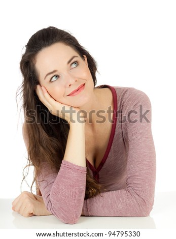 Portrait of a beautiful young woman smiling and daydreaming. Isolated on white. - stock photo