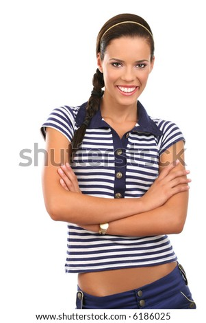 Portrait of a beautiful young woman standing and smiling, isolated on white