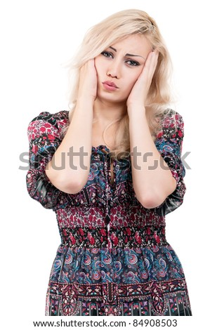 Portrait of a beautiful young woman suffering from severe headache - isolated on white background - stock photo