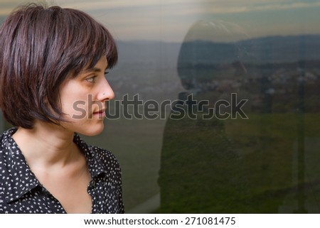 Portrait of a beautiful young woman thinking - stock photo