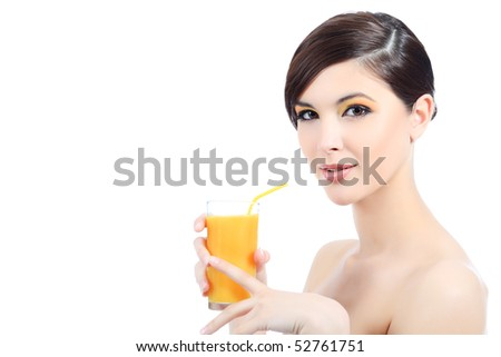 Portrait of a beautiful young woman with a glass of orange juice. Isolated over white background. - stock photo