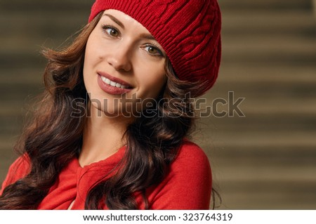Portrait of a beautiful young woman with background stairs outdoors. beautiful young woman smiling. wearing red dress, beret