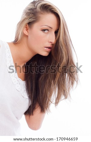 Portrait of a beautiful young woman with brunette hair on white background - stock photo
