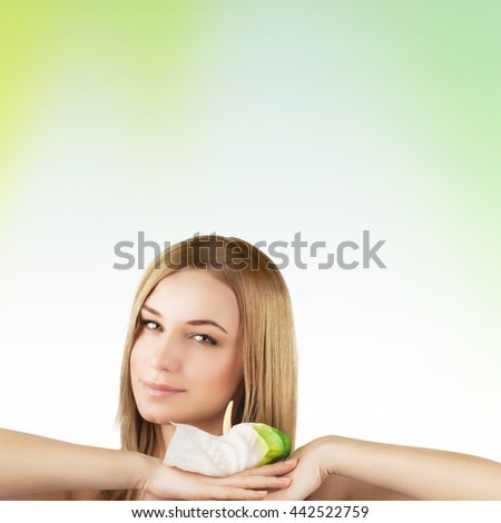 Portrait of a beautiful young woman with calla flower over clear background, healthy lifestyle, beauty treatment, enjoying dayspa - stock photo