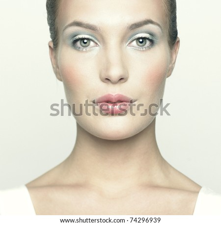 Portrait of a beautiful young woman with doll makeup - stock photo