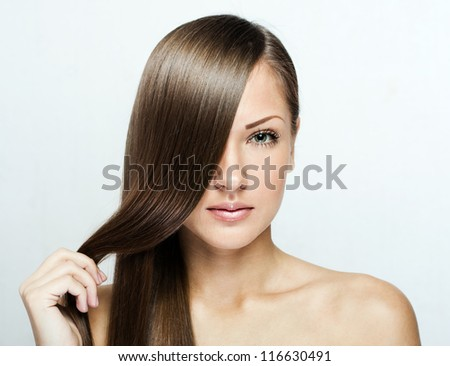portrait of a beautiful young woman with elegant long shiny hair - stock photo