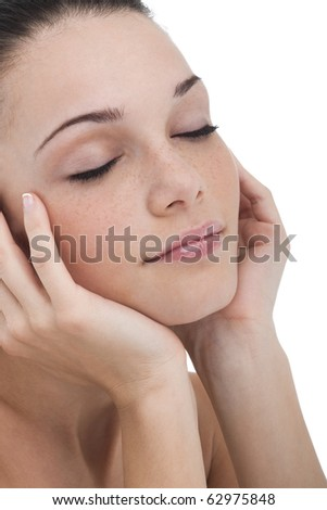 Portrait of a beautiful young woman with eyes closed, relaxing or dreaming - stock photo
