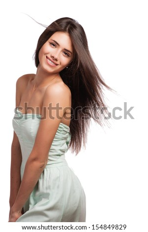 Portrait of a beautiful young woman with hair flying - stock photo