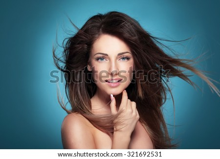 Portrait of a beautiful young woman with hair flying. - stock photo