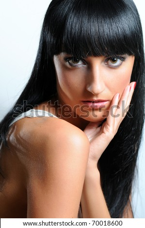 Portrait of a beautiful young woman with long black hair - stock photo