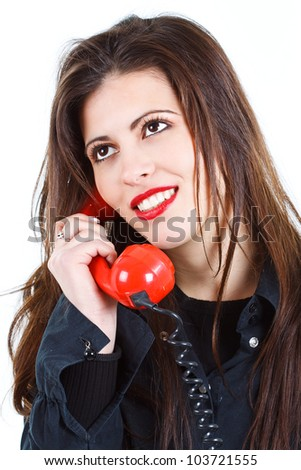 Portrait of a beautiful young woman with long brown hair, holding a red retro telephone receiver, smiling, looking up - isolated on white
