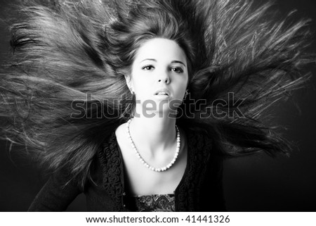 Portrait of a beautiful young woman with luxurious hair