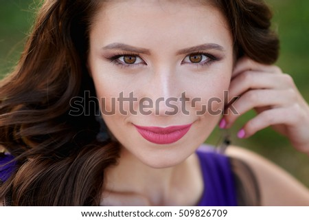 portrait of a beautiful young woman with make-up closeup