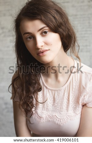 Portrait of a beautiful young woman with no makeup. Natural beauty concept