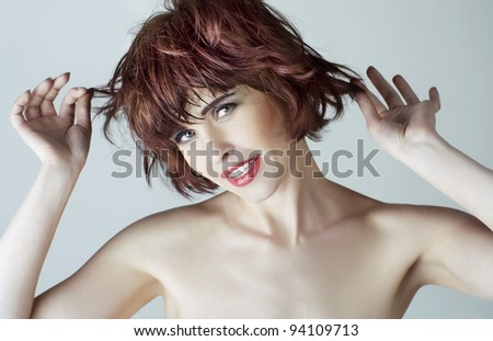 portrait of a beautiful young woman with red short hairs - stock photo
