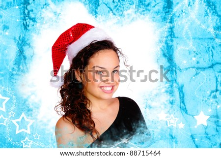 Portrait of a beautiful young woman with santa hat