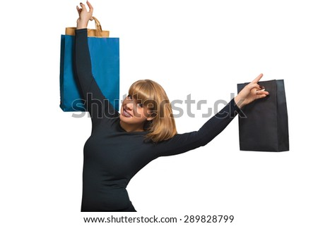 Portrait of a beautiful young woman with shopping on a white background - stock photo