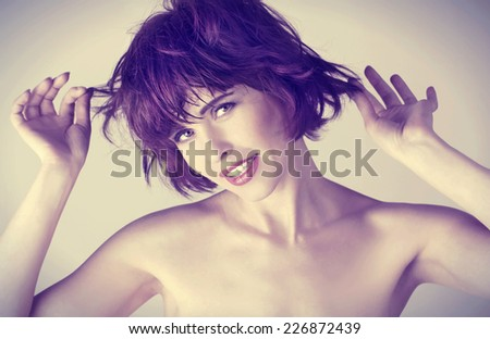 portrait of a beautiful young woman with short hairs  - stock photo
