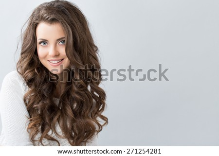 Portrait of a beautiful young woman with wavy hair. Beauty and Fashion - stock photo