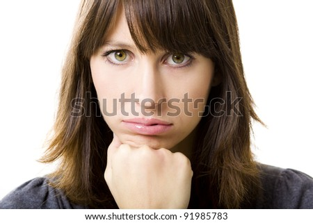 Portrait of a beautiful young woman worried with something, isolated on white background - stock photo