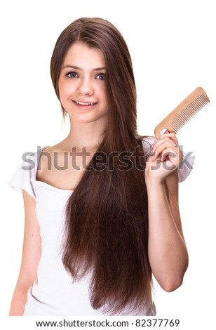 portrait of a beautiful youth teen girl with comb isolated - stock photo
