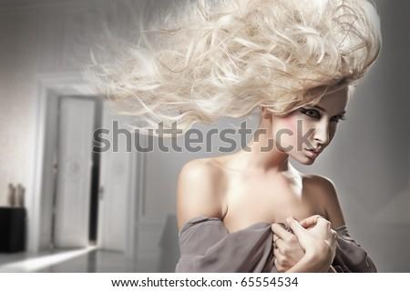 Portrait of a beauty blonde - stock photo