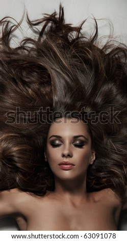 Portrait of a beauty brunette - stock photo