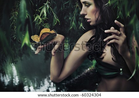 Portrait of a beauty brunette with butterfly - stock photo