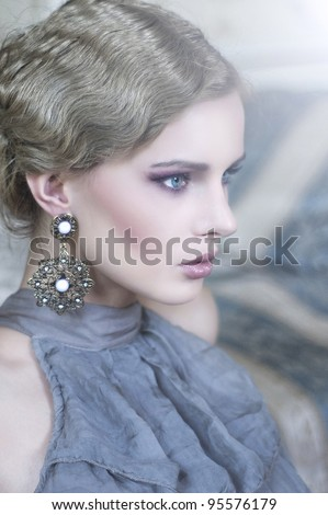 Portrait of a beauty woman in stylish room - stock photo