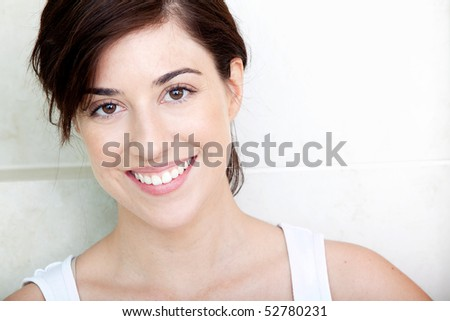 Portrait of a beauty woman smiling indoors - stock photo