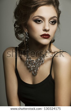 portrait of a beautyful woman  with perfect makeup wearing jewelry - stock photo