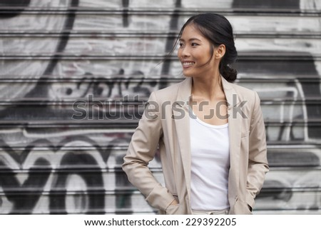 portrait of a beutuful girl on the street - stock photo
